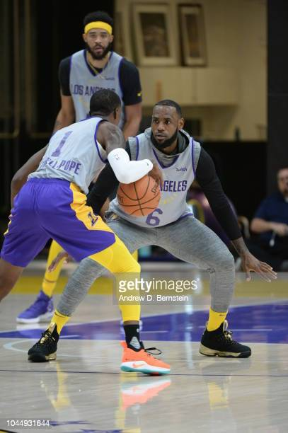 Kentavious CaldwellPope handles the ball against LeBron James of the Los Angeles Lakers at practice at UCLA Health Training Center on September 25...