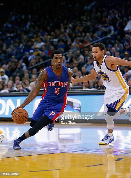 Kentavious CaldwellPope of the Detroit Pistons dribbles around Stephen Curry of the Golden State Warriors at ORACLE Arena on November 9 2015 in...