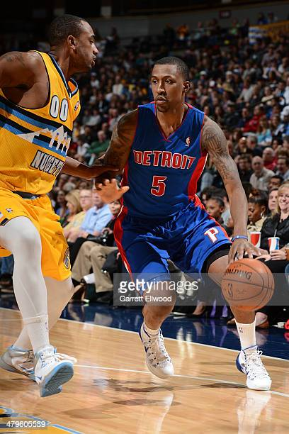 Kentavious CaldwellPope of the Detroit Pistons drives to the basket against the Denver Nuggets on March 19 2014 at the Pepsi Center in Denver...