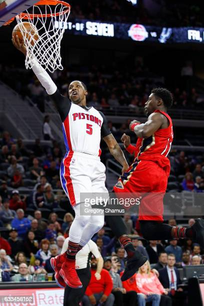 Kentavious CaldwellPope of the Detroit Pistons gets to the basket past Jrue Holiday of the New Orleans Pelicans during the second half at the Palace...