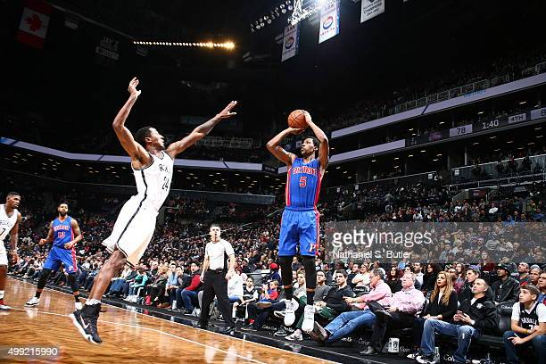 Kentavious CaldwellPope of the Detroit Pistons shoots the ball against the Brooklyn Nets on November 29 2015 at Barclays Center in Brooklyn New York...