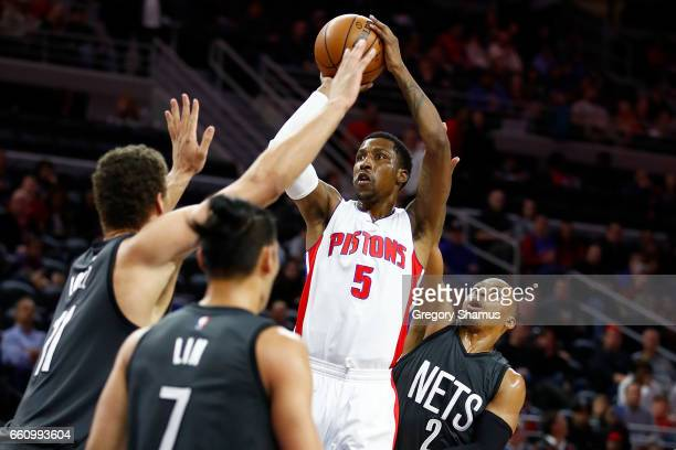 Kentavious CaldwellPope of the Detroit Pistons takes a shot next to Randy Foye of the Brooklyn Nets during the first half at the Palace of Auburn...