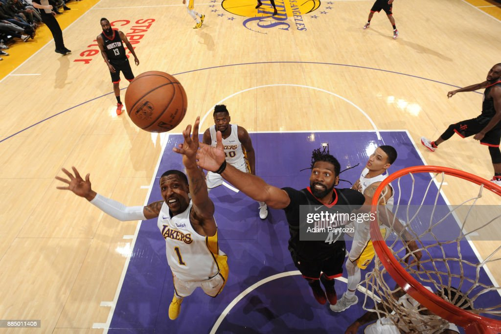 Kentavious Caldwell-Pope #1 of the Los Angeles Lakers and Nene Hilario #42 of the Houston Rockets battle for the rebound on December 3, 2017 at STAPLES Center in Los Angeles, California.