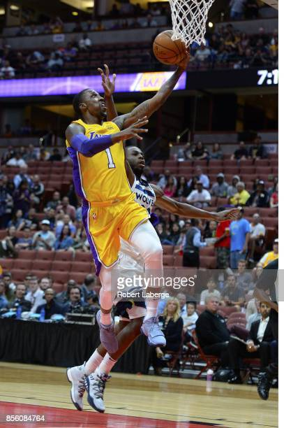 Kentavious CaldwellPope of the Los Angeles Lakers attempts a lay up against Andrew Wiggins of the Minnesota Timberwolves on September 30 2017 at the...