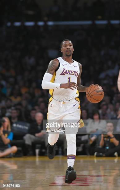 Kentavious CaldwellPope of the Los Angeles Lakers brings the ball up the floor in the first half at Staples Center on April 8 2018 in Los Angeles...