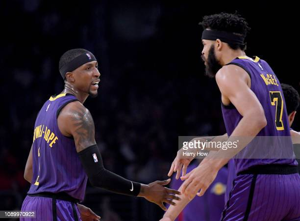 Kentavious CaldwellPope of the Los Angeles Lakers celebrates his three with JaVale McGee during the first half against the New York Knicks at Staples...