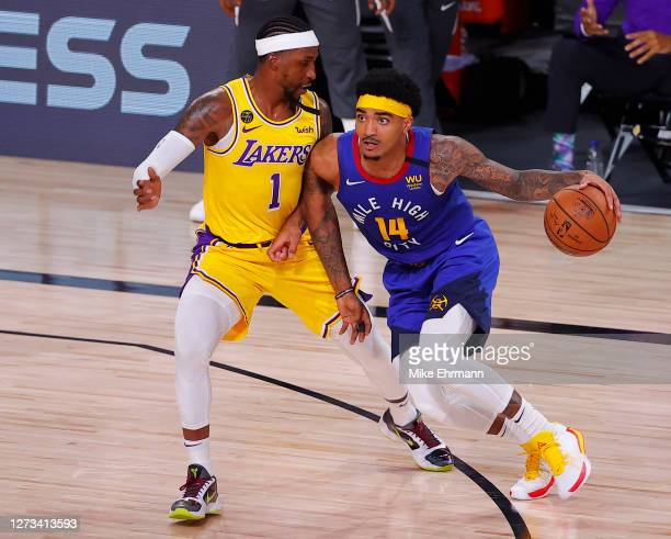 Kentavious CaldwellPope of the Los Angeles Lakers defends against Gary Harris of the Denver Nuggets during the third quarter in Game One of the...