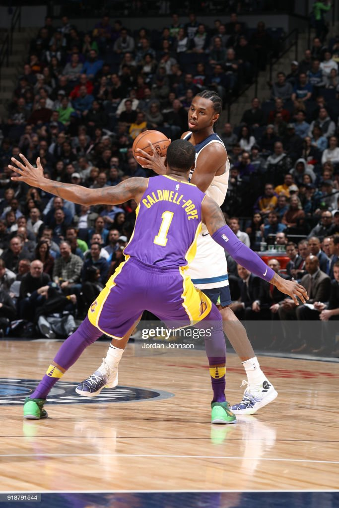 Kentavious Caldwell-Pope #1 of the Los Angeles Lakers defends against Andrew Wiggins #22 of the Minnesota Timberwolves during the game between the two teams on February 15, 2018 at Target Center in Minneapolis, Minnesota.