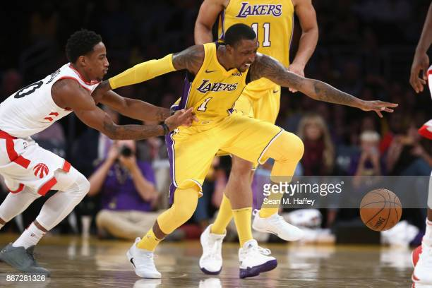 Kentavious CaldwellPope of the Los Angeles Lakers dribbles past DeMar DeRozan of the Toronto Raptors during the second half of a game at Staples...