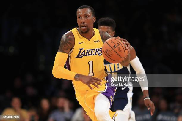 Kentavious CaldwellPope of the Los Angeles Lakers dribbles past Malik Beasley of the Denver Nuggets during the second half of a preseason game at...