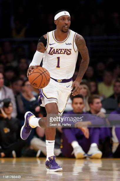 Kentavious CaldwellPope of the Los Angeles Lakers dribbles the ball during the first half of a game against the Golden State Warriors at Staples...