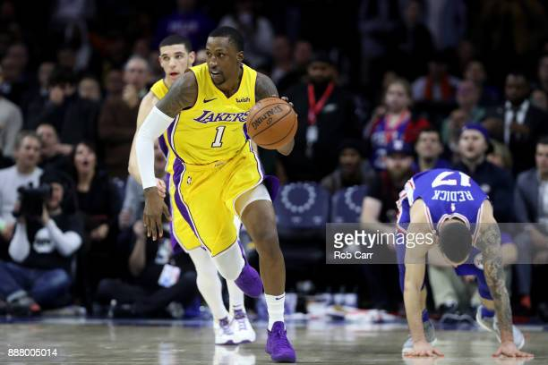 Kentavious CaldwellPope of the Los Angeles Lakers dribbles the ball after stealing it from JJ Redick of the Philadelphia 76ers in the second half at...