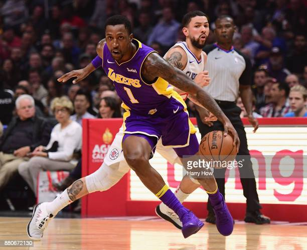 Kentavious CaldwellPope of the Los Angeles Lakers drives to the basket past Austin Rivers of the LA Clippers during the first quarter in a 120115 LA...