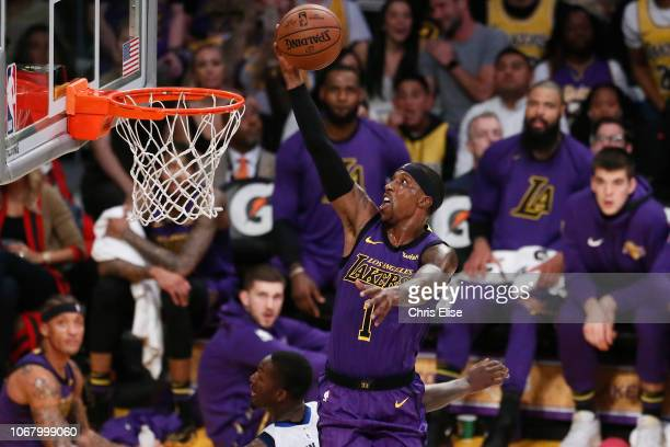 Kentavious CaldwellPope of the Los Angeles Lakers drives to the basket against the Dallas Mavericks on November 30 2018 at the Staples Center in Los...