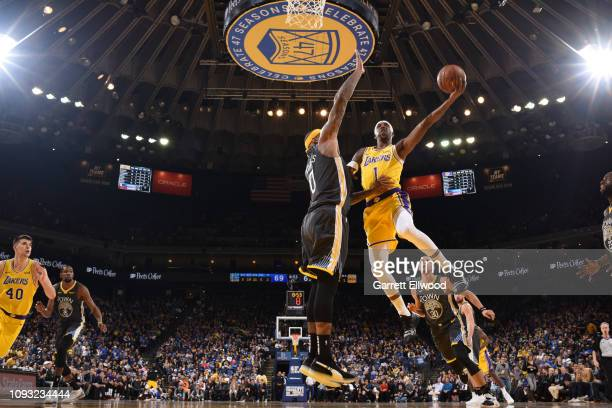 Kentavious CaldwellPope of the Los Angeles Lakers drives to the basket against the Golden State Warriors on February 2 2019 at the Pepsi Center in...