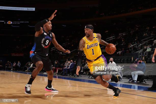 Kentavious Caldwell-Pope of the Los Angeles Lakers drives to the basket during the game against the New York Knicks on April 12, 2021 at Madison...
