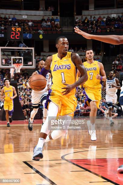 Kentavious CaldwellPope of the Los Angeles Lakers drives to the basket during the game against the Minnesota Timberwolves during the preseason game...