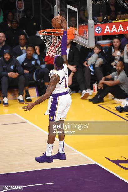 Kentavious CaldwellPope of the Los Angeles Lakers dunks the ball against the Memphis Grizzlies on December 23 2018 at STAPLES Center in Los Angeles...