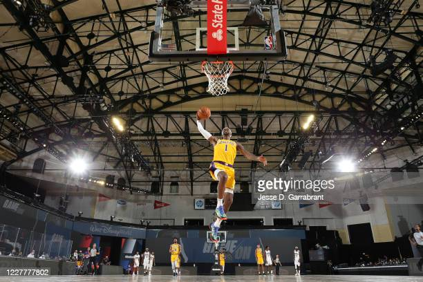 Kentavious Caldwell-Pope of the Los Angeles Lakers dunks the ball against the Orlando Magic during a scrimmage on July 25, 2020 at HP Field House at...