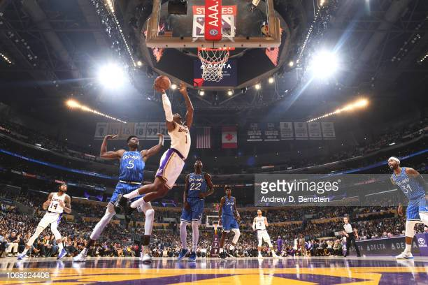 Kentavious CaldwellPope of the Los Angeles Lakers goes to the basket against the Orlando Magic on November 25 2018 at STAPLES Center in Los Angeles...