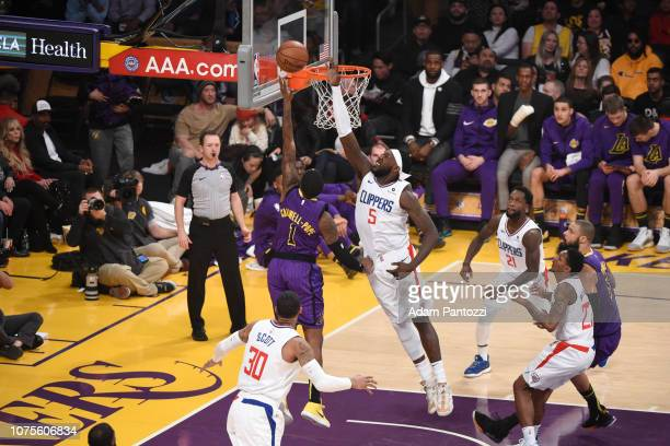 Kentavious CaldwellPope of the Los Angeles Lakers goes to the basket against Montrezl Harrell of the LA Clippers on December 28 2018 at STAPLES...