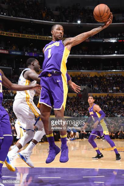Kentavious CaldwellPope of the Los Angeles Lakers grabs the rebound against the Golden State Warriors on November 29 2017 at STAPLES Center in Los...
