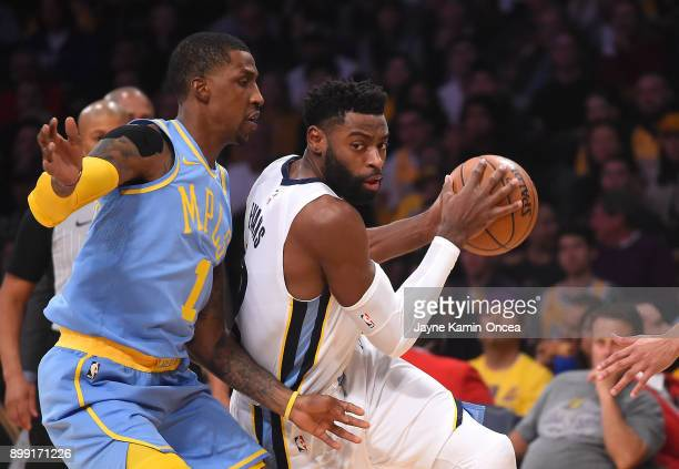 Kentavious CaldwellPope of the Los Angeles Lakers guards Tyreke Evans of the Memphis Grizzlies as he drives to the basket in the first half of the...