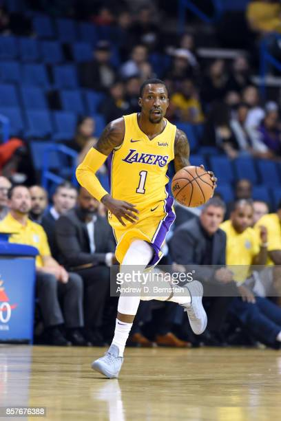 Kentavious CaldwellPope of the Los Angeles Lakers handles the ball against the Denver Nuggets on October 4 2017 at Citizens Business Bank Arena in...