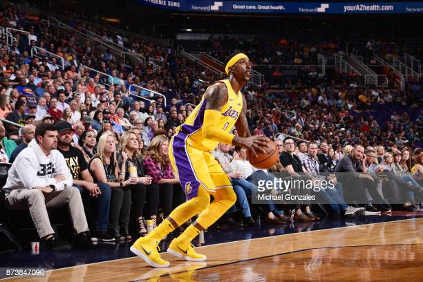 Kentavious CaldwellPope of the Los Angeles Lakers handles the ball against the Phoenix Suns on November 13 2017 at Talking Stick Resort Arena in...