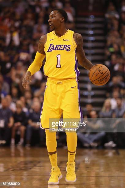 Kentavious CaldwellPope of the Los Angeles Lakers handles the ball during the NBA game against the Phoenix Suns at Talking Stick Resort Arena on...