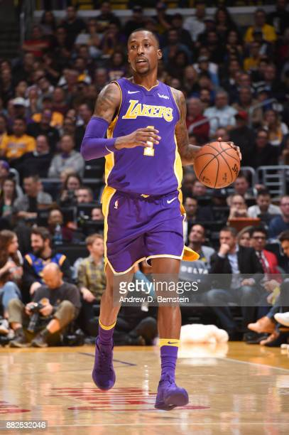 Kentavious CaldwellPope of the Los Angeles Lakers handles the ball against the Golden State Warriors on November 29 2017 at STAPLES Center in Los...