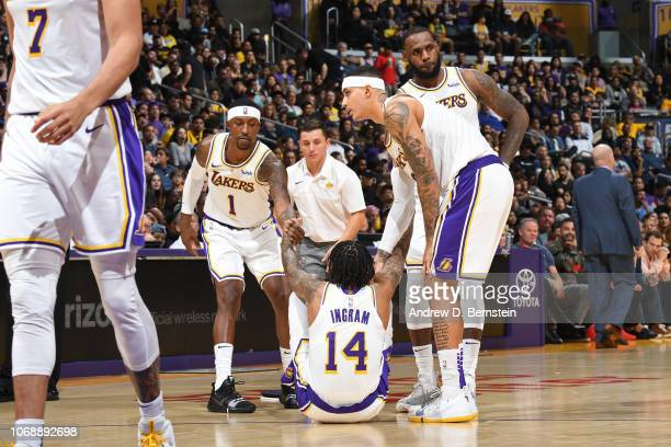 Kentavious CaldwellPope of the Los Angeles Lakers helps Brandon Ingram of the Los Angeles Lakers up during a game against the Orlando Magic on...