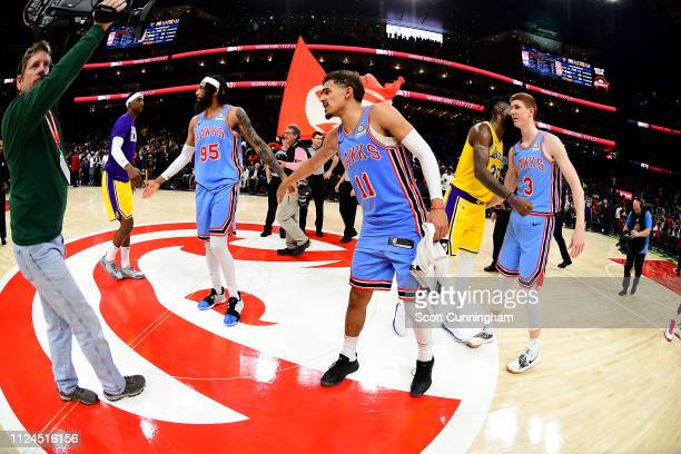 Kentavious CaldwellPope of the Los Angeles Lakers hifives DeAndre' Bembry of the Atlanta Hawks and Trae Young of the Atlanta Hawks after the game on...