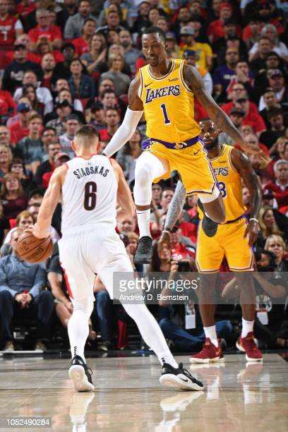 Kentavious CaldwellPope of the Los Angeles Lakers jumps to defend Nik Stauskas of the Portland Trail Blazers on October 18 2018 at the Moda Center...