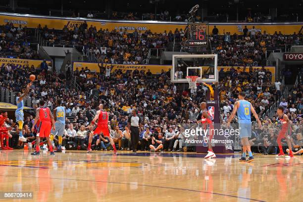 Kentavious CaldwellPope of the Los Angeles Lakers makes the go ahead three point basket against the Washington Wizards on October 25 2017 at STAPLES...