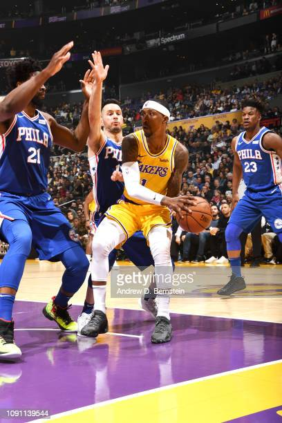 Kentavious CaldwellPope of the Los Angeles Lakers passes the ball against the Philadelphia 76ers on January 21 2019 at STAPLES Center in Los Angeles...