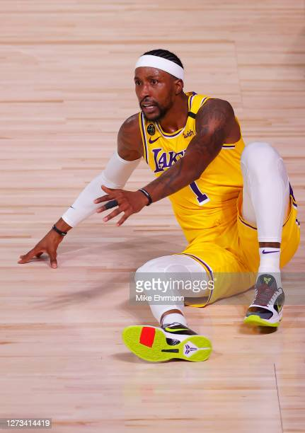 Kentavious CaldwellPope of the Los Angeles Lakers reacts against the Denver Nuggets during the third quarter in Game One of the Western Conference...