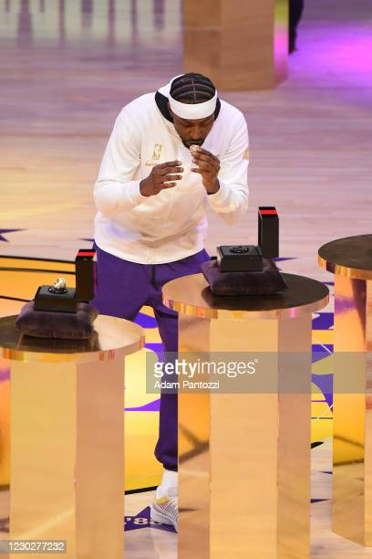 Kentavious Caldwell-Pope of the Los Angeles Lakers reacts as he gets his 2019-20 NBA Championship ring during the ring ceremony before the game...