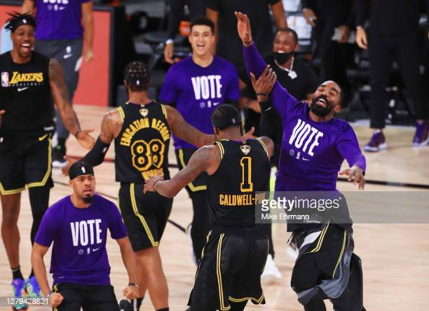 Kentavious Caldwell-Pope of the Los Angeles Lakers reacts with his teammates during the fourth quarter against the Miami Heat in Game Five of the...