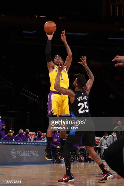 Kentavious Caldwell-Pope of the Los Angeles Lakers shoots a three point basket during the game against the New York Knicks on April 12, 2021 at...