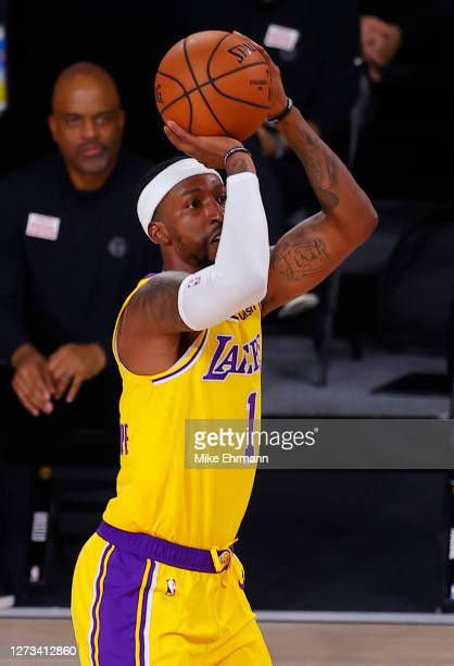 Kentavious CaldwellPope of the Los Angeles Lakers shoots against the Denver Nuggets during the third quarter in Game One of the Western Conference...