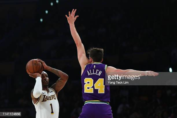 Kentavious CaldwellPope of the Los Angeles Lakers shoots the ball against Grayson Allen of the Utah Jazz during the first half at Staples Center on...