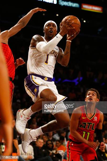 Kentavious CaldwellPope of the Los Angeles Lakers shoots the ball during the second half of a game against the Atlanta Hawks at Staples Center on...