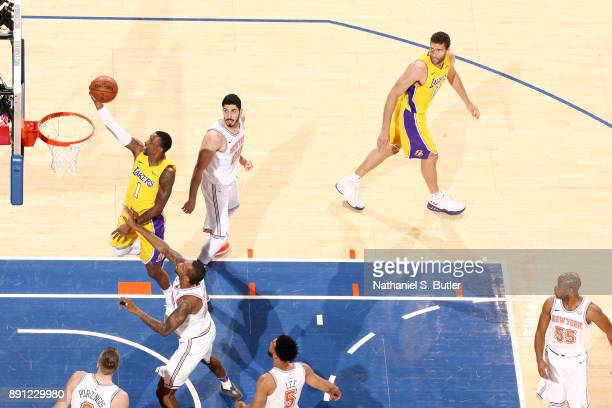 Kentavious CaldwellPope of the Los Angeles Lakers shoots the ball during the game against the New York Knicks on December 12 2017 at Madison Square...