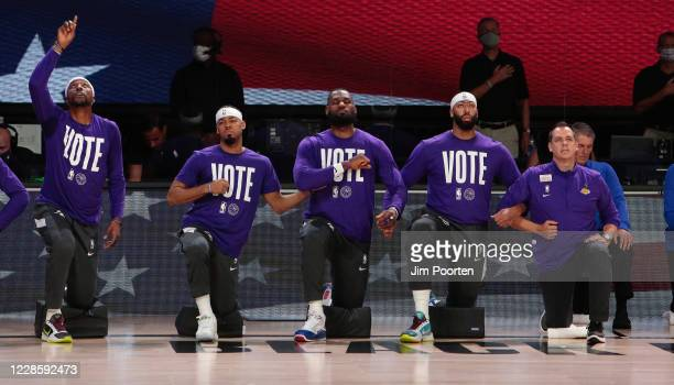 Kentavious CaldwellPope Quinn Cook LeBron James Anthony Davis and Head Coach Frank Vogel of the Los Angeles Lakers during the national anthem against...