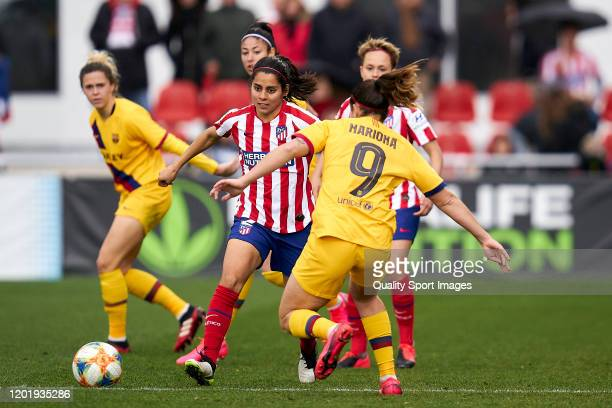 Kenti Robles of Atletico de Madrid battle for the ball with María Francesca Caldentey of FC Barcelona during the Spanish women's league Liga...
