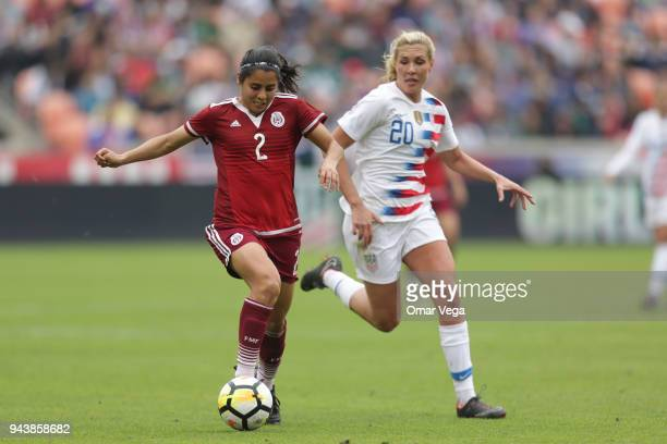 Kenti Robles of Mexico and Allie Long of United States fight for the ball during the match between Mexico and United States at BBVA Compass Stadium...