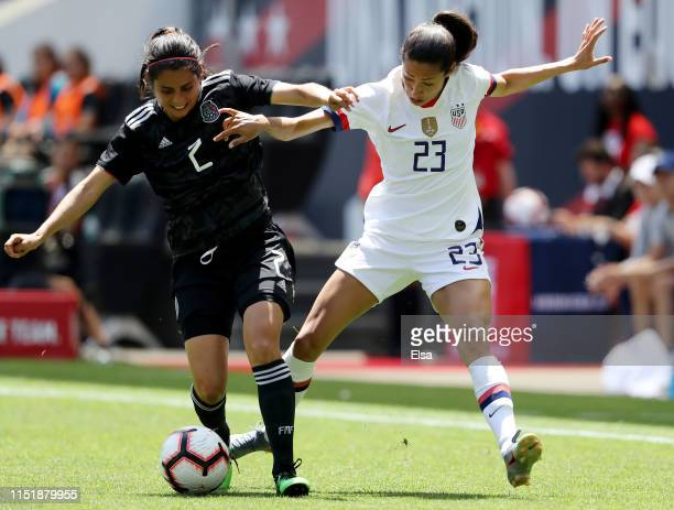 Kenti Robles of Mexico and Christen Press of the United States fight for the ball in the second half at Red Bull Arena on May 26 2019 in Harrison New...
