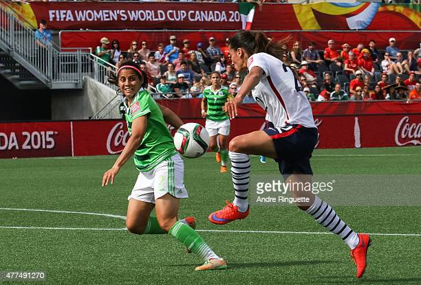 Kenti Robles of Mexico defends against Amel Majri of France during the FIFA Women's World Cup Canada 2015 Group F match between Mexico and France at...