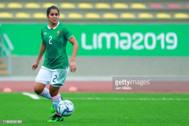 Kenti Robles of Mexico drives the ball during Women's First Round Group A match between Mexico and Colombia at San Marcos Stadium on Day 8 of Lima...